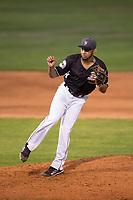 Salem-Keizer Volcanoes relief pitcher Luis Moreno (12) follows through on his delivery during a Northwest League game against the Eugene Emeralds at Volcanoes Stadium on August 31, 2018 in Keizer, Oregon. The Eugene Emeralds defeated the Salem-Keizer Volcanoes by a score of 7-3. (Zachary Lucy/Four Seam Images)