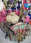 Colorful items for sale in Mexican gift shop like hats crosses turtles