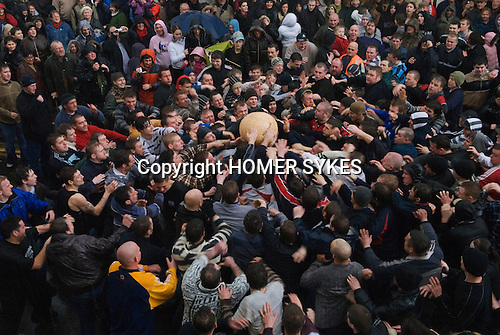 Shrove Tuesday Football Atherstone Warwickshire UK . Start of the game ball thrown into the crowd.