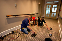 Carpet layers work in the White House West Wing in Washington, DC in the hallway that leads from the Upper Press Office to the Lower Press Office on onto the Colonnade as it is undergoing renovations while United States President Donald J. Trump is vacationing in Bedminster, New Jersey on Friday, August 11, 2017.<br /> Credit: Ron Sachs / CNP /MediaPunch