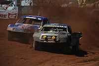 Apr 16, 2011; Surprise, AZ USA; LOORRS driver Rick Huseman (36) races alongside Ricky Johnson (48) during round 3 at Speedworld Off Road Park. Mandatory Credit: Mark J. Rebilas-.