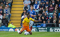 Marcus Bean of Wycombe Wanderers goes down during the Sky Bet League 2 match between Portsmouth and Wycombe Wanderers at Fratton Park, Portsmouth, England on 23 April 2016. Photo by Andy Rowland.