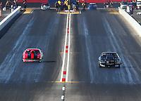 Feb 25, 2017; Chandler, AZ, USA; NHRA top sportsman driver Bud Preuss (left) races alongside Josh Edwards during qualifying for the Arizona Nationals at Wild Horse Pass Motorsports Park. Mandatory Credit: Mark J. Rebilas-USA TODAY Sports