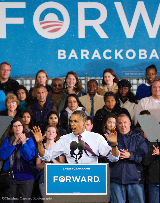 September 22, 2012- Milwaukee, United States: President Barack Obama addresses a crowd of thousands at the Summerfest grounds as rain falls. Supporters endured a cool shower and remained energized during the 30 minute speech. (Christina Capasso/Polaris)