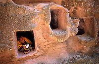 ETHIOPIA Lalibela, rock church, the monolith rock churches were built by King Lalibela 800 years ago / AETHIOPIEN Lalibela oder Roha, Einsiedler in Hoehle einer Felsenkirche , Koenig LALIBELA liess die monolithischen Felsenkirchen vor ueber 800 Jahren in die Basaltlava auf 2600 Meter Hoehe hauen und baute ein zweites Jerusalem nach