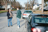 New Hampshire Public Radio reporter Josh Rogers (in green) interviews campaign volunteer Doris Hohensee, of Nashua, before she canvasses the neighborhood for the campaign of Kentucky senator and Republican presidential candidate Rand Paul in Nashua, New Hampshire. She canvassed a Nashua neighborhood after a short diner stop by the candidate earlier that morning. The canvassing efforts were mostly to determine which candidates and policies likely voters in the neighborhood were interested in.