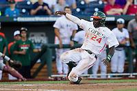 Miami Hurricanes outfielder Jacob Heyward (24) slides home during the NCAA College baseball World Series against the Arkansas Razorbacks  on June 15, 2015 at TD Ameritrade Park in Omaha, Nebraska. Miami beat Arkansas 4-3. (Andrew Woolley/Four Seam Images)