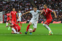 Gary Cahill (Chelsea) of England holds off Andrei Agius of Malta (right) during the FIFA World Cup qualifying match between England and Malta at Wembley Stadium, London, England on 8 October 2016. Photo by David Horn / PRiME Media Images.