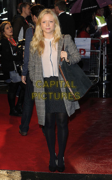 Naomi Battrick.The 'Blood' official screening, 56th BFI London Film Festival Day 2, Odeon West End cinema, Leicester Square, London, England..October 11th, 2012.full length black jacket check skirt tights grey gray bag purse blouse hand in pocket .CAP/CAN.©Can Nguyen/Capital Pictures.