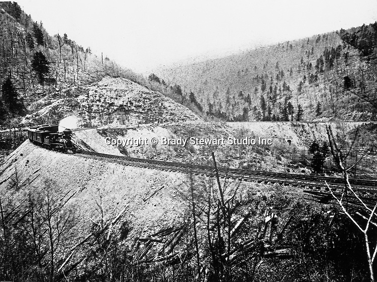 "Altoona PA:  Brady Stewart went to Altoona Pennsylvania during the winter of 1903 and took this photograph of the famous Horseshoe Curve - 1903.   Called an ""engineering marvel"", it was completed in 1854 by the Pennsylvania Railroad. It was later used by the Penn Central, then Conrail, and is currently owned and operated by the Norfolk Southern Railway."