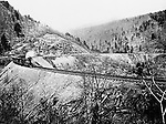 """Altoona PA:  Brady Stewart went to Altoona Pennsylvania during the winter of 1903 and took this photograph of the famous Horseshoe Curve - 1903.   Called an """"engineering marvel"""", it was completed in 1854 by the Pennsylvania Railroad. It was later used by the Penn Central, then Conrail, and is currently owned and operated by the Norfolk Southern Railway."""