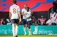 Harry Kane (Tottenham Hotspur) with goalscorer Raheem Sterling (Manchester City) of England during the UEFA 2020 Euro Qualifier match between England and Bulgaria at Wembley Stadium, London, England on 7 September 2019. Photo by Andy Rowland.