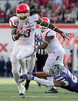 NWA Democrat-Gazette/JASON IVESTER <br /> Arkansas vs Kansas St, Liberty Bowl<br /> Arkansas running back Alex Collins (3) slips out of a tackle attempt from Kansas State strong safety Kendall Adams during the first quarter on Saturday, Jan. 2, 2016, at the Liberty Bowl in Memphis, Tenn.