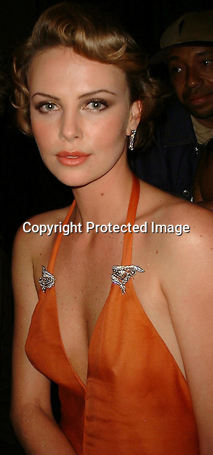 Charlize Theron <br />2000 Vanity Fair Post Oscar Party<br />Morton's Restaurant<br />Los Angeles, California, USA<br />March 26, 2000<br />Photo by Celebrityvibe.com