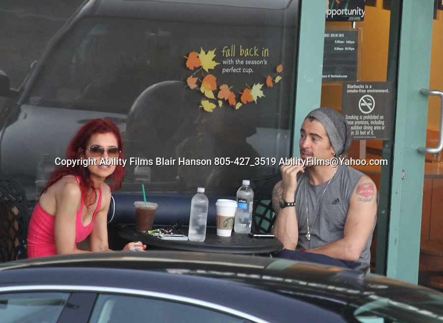 October 12th 2011  Exclusive ...Colin Farrell took a Yoga class with a pretty red head woman in Los Angeles. After  the Yoga class the couple walked next door to StarBucks & grabbed a coffee. Colin was shirtless inside the class but wore a sleeveless shirt showing off his red heart tattoo's  .& making some really funny faces laughing while eating a banana. When Colin saw the photographer he split from the woman & left carrying his Yoga mat ..AbilityFilms@yahoo.com.805-427-3519.www.AbilityFilms.com.