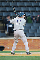 Patrick Camporini (11) of the Georgetown Hoyas at bat against the Wake Forest Demon Deacons at Wake Forest Baseball Park on February 16, 2014 in Winston-Salem, North Carolina.  The Demon Deacons defeated the Hoyas 3-2.  (Brian Westerholt/Four Seam Images)