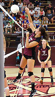 Photo by Randy Moll<br /> Hannah Boss, Gentry sophomore, hits one over the net during play against Shiloh Christian at Gentry High School on Thursday, Sept. 10, 2015.