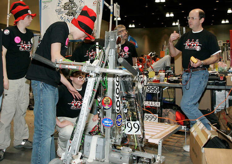 HARTFORD, CT. 16 March 2007--16_NEW_031607SV09--At right, Doug Shidler Cheshire High School team mentor helps the team check their robot before a match at the United Technologies Connecticut Regional 2007 First Robotics Competition at the Connecticut Convention Center in Hartford Friday.<br /> Steven Valenti Republican-American