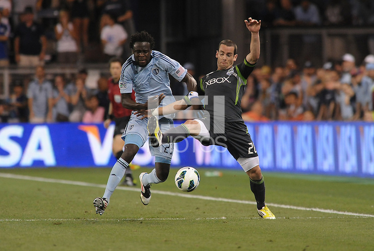 Zach Scott (20) defender Seattle Sounders holds off Kei Kamara (23) forward Sporting KC..Sporting Kansas City defeated Seattle Sounders on penalty kicks, after a 1-1 tied game to win the Lamar Hunt Open Cup at LIVESTRONG Sporting Park, Kansas City, Kansas..