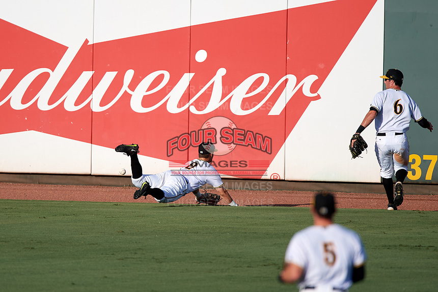 Bradenton Marauders center fielder Logan Ratledge (2) makes a diving attempt to catch a ball as right fielder Kevin Krause (6) backs up the play during a game against the Clearwater Threshers on July 24, 2017 at LECOM Park in Bradenton, Florida.  Bradenton defeated Clearwater 6-3  (Mike Janes/Four Seam Images)