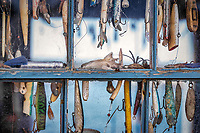 Hooks and lures in a fishing shack window, Menemsha, Cillmark, Martha's Vineyard, Massachusetts, USA.