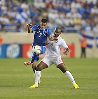 Darwin Ceren Delgado (7) of El Salvador goes against Khaleem Hyland (8) of Trinidad & Tobago.  Trinidad & Tobago tied El Salvador 1-1 in the first round of the Concacaf Gold Cup, at Red Bull Arena, Monday July 8 , 2013.