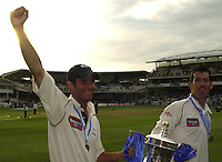 Photo Peter Spurrier.31/08/2002.Cheltenham & Gloucester Trophy Final - Lords.Somerset C.C vs YorkshireC.C..Yorkshire Michael Vaughan left and Matt Elliott with the C&G Trophy