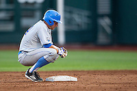 UCLA catcher Shane Zeile (14) rests on second base during Game 1 of the 2013 Men's College World Series Finals against the Mississippi State Bulldogs on June 24, 2013 at TD Ameritrade Park in Omaha, Nebraska. The Bruins defeated the Bulldogs 3-1, taking a 1-0 lead in the best of 3 series. (Andrew Woolley/Four Seam Images)
