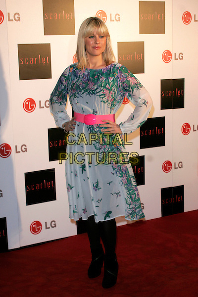 "GEORGINA BOUZOVA.""Scarlet"" - TV series launch, No. 1 Marylebone, Marylebone Road, London, England..April 30th, 2008.full length white green pink floral print pattern dress belt black tights hands on hips .CAP/AH.©Adam Houghton/Capital Pictures."