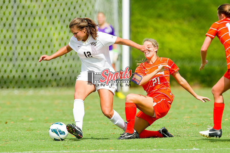 Katie Stengel (12) of the Wake Forest Demon Deacons tries to keep the ball away from Maddy Elder (21) of the Clemson Tigers at Spry Soccer Stadium on September 30, 2012 in Winston-Salem, North Carolina.  The Demon Deacons defeated the Tigers 4-0.  (Brian Westerholt/Sports On Film)