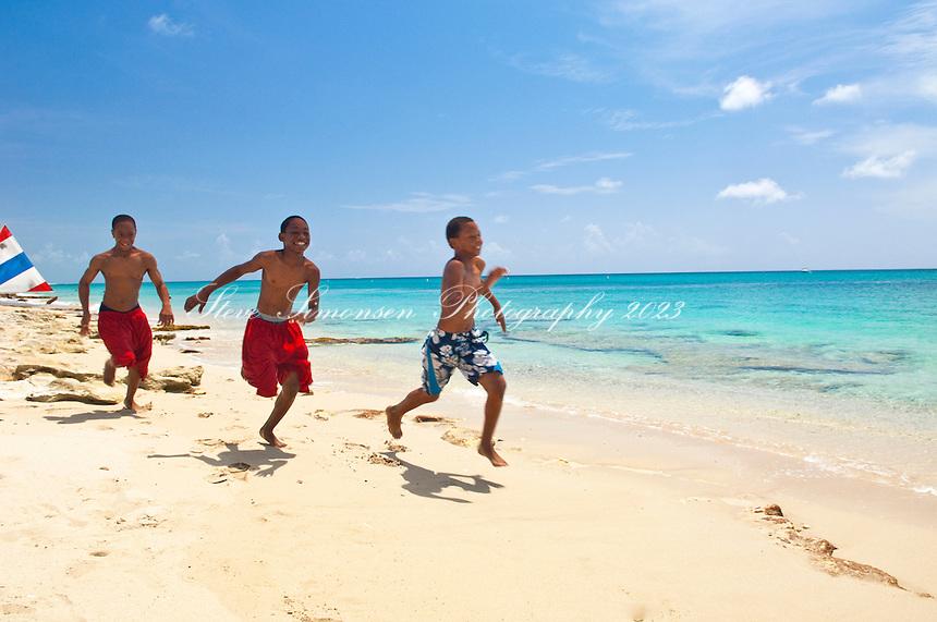 Boys running at Dorsch Beach near Fredericksted<br /> St Croix<br /> U.S. Virgin Islands
