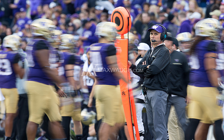 Chris Petersen shows his usual game day intensity.