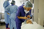 Nurse applying dressing to a patient after eye surgery