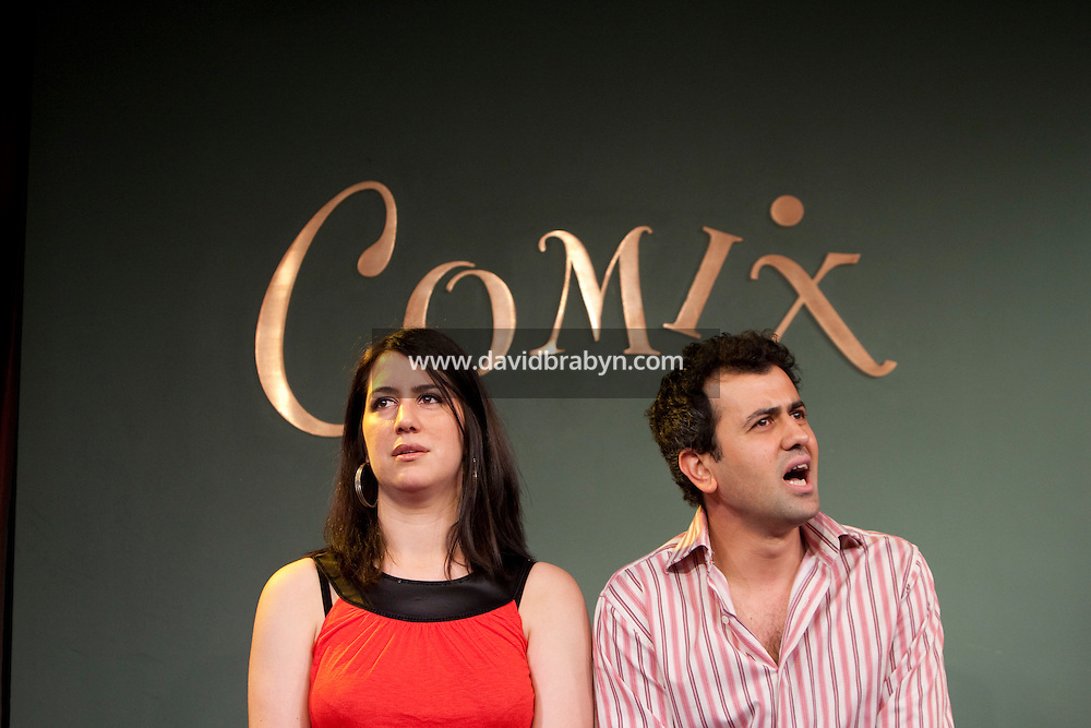 Comedians Sarah Siadat (L) and Daoud Heidami perform in the 6th Annual NY Arab-American Comedy Festival in New York, USA, 10 May 2009.
