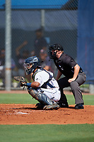 GCL Rays catcher Michael Berglund (8) awaits a pitch in front of home plate umpire Joe Belangia during a game against the GCL Twins on August 9, 2018 at Charlotte Sports Park in Port Charlotte, Florida.  GCL Twins defeated GCL Rays 5-2.  (Mike Janes/Four Seam Images)