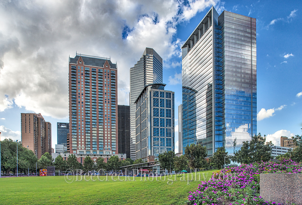 We capture this image as we came up to the discovery green park in Houston right across from the new George Brown Convention center and we thought it was pretty with the colorful flowers and the high-rises in the distance.