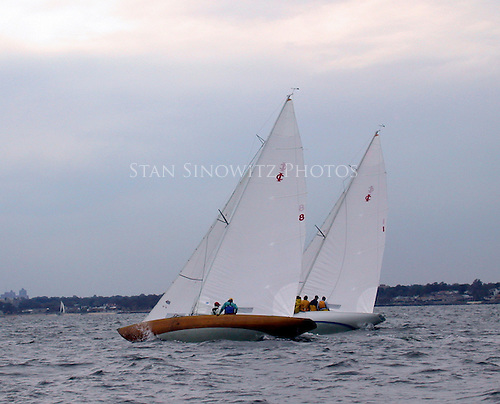 These wooden International One Designs are racing in Long Island Sount off of Larchment, NY.  The crew is on the high side of the boat as sitting live ballest.