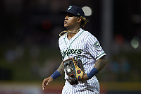 Gwinnett Stripers right fielder Cristian Pache (15) jogs off the field between innings of the game against the Scranton/Wilkes-Barre RailRiders at BB&T BallPark on August 17, 2019 in Lawrenceville, Georgia. The Stripers defeated the RailRiders 8-7 in eleven innings. (Brian Westerholt/Four Seam Images)