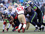 Seattle Seahawks running back Thomas Rawls (34) fights for first down yardage against San Francisco 49ers linebackers Michael Wilhoite (57) and NaVorro Bowman (53) at CenturyLink Field in Seattle, Washington on November 22, 2015.  The Seahawks beat the 49ers 29-13.   ©2015. Jim Bryant Photo. All RIghts Reserved.