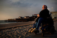 """Redondo Beach, California, December 15, 2011 – A portrait of author and anti-war activist Ron Kovic near the Redondo Beach Pier a few blocks from where he lives. He says he loves the pier and visits often. Kovic is best known as the author of the memoir Born on the Fourth of July, which was made into an Academy Award–winning movie directed by Oliver Stone, with Tom Cruise playing Kovic. He received the Golden Globe Award for Best Screenplay on January 20, 1990, exactly 22 years to the day that he was wounded in Vietnam and was also nominated for an Academy Award for best screenplay. Kovic, who volunteered and served for two tours in Vietnam, was shot through the chest and foot leaving him paralyzed from the chest down. His politics about the war began to change after the shootings at Kent State. He spoke at rallies opposing the war and was arrested 12 times for political protest, including a famous interruption of the 1972 Republican National Convention. In 1974 he led a hunger strike protesting the poor treatment of injured veterans returning from the war and was instrumental in changing conditions in the country's Veterans Affairs facilities. He has since worked to help returning veterans, VA conditions and as an anti-war spokesman. ..Kovic remains upbeat and a force to be reakoned with, despite his adversity. He says his doctors told him early on that he wouldn't live to 30. """"I proved them wrong,"""" says Kovic. Adding that his tragedy has been a blessing in that it has led him on a mission on behalf of peace."""