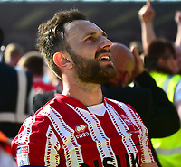 Lincoln City's Neal Eardley celebrates securing the League 2 Title<br /> <br /> Photographer Andrew Vaughan/CameraSport<br /> <br /> The EFL Sky Bet League Two - Lincoln City v Tranmere Rovers - Monday 22nd April 2019 - Sincil Bank - Lincoln<br /> <br /> World Copyright © 2019 CameraSport. All rights reserved. 43 Linden Ave. Countesthorpe. Leicester. England. LE8 5PG - Tel: +44 (0) 116 277 4147 - admin@camerasport.com - www.camerasport.com