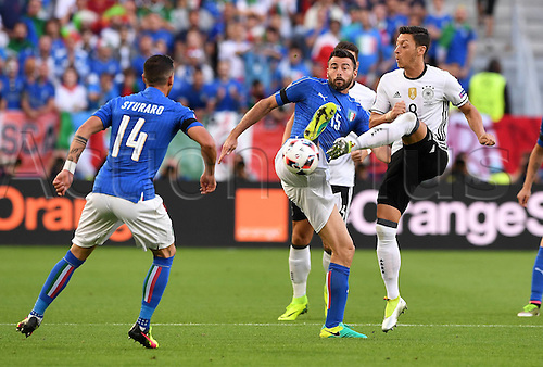 02.07.2016. Bordeaux, France. 2016 European football championships. Quarterfinals match. Germany versus Italy.  Mesut Oezil (Ger) Francesco Acerbi and Jorginho (Ita)