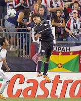 New England Revolution defender Kevin Alston (30) heads the ball. In a Major League Soccer (MLS) match, the Los Angeles Galaxy defeated the New England Revolution, 1-0, at Gillette Stadium on May 28, 2011.