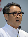 January 30, 2014, Tokyo, Japan - President Akio Toyoda of Japan's Toyota Motor Corp., takes off his business suit for presenting its motor sports activities for 2014 in Tokyo on Thursday, January 30, 2014. They will include participation in the FIA World Endurance Championship and the Le Mans 24-hour race, the NASCAR racing series and the Super GT and Super Formula championships. Toyoda said its motor sports activities through Lexus Racing and Toyota Racing are aimed to bring more joy to more people through automobiles.  (Photo by Natsuki Sakai/AFLO)