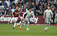 Manchester United's Jesse Lingard and West Ham United's Joao Mario<br /> <br /> Photographer Rob Newell/CameraSport<br /> <br /> The Premier League - West Ham United v Manchester United - Thursday 10th May 2018 - London Stadium - London<br /> <br /> World Copyright &copy; 2018 CameraSport. All rights reserved. 43 Linden Ave. Countesthorpe. Leicester. England. LE8 5PG - Tel: +44 (0) 116 277 4147 - admin@camerasport.com - www.camerasport.com
