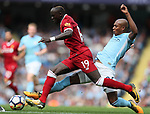 Sadio Mane of Liverpool tackled by Fernandinho of Manchester City during the premier league match at the Etihad Stadium, Manchester. Picture date 9th September 2017. Picture credit should read: David Klein/Sportimage