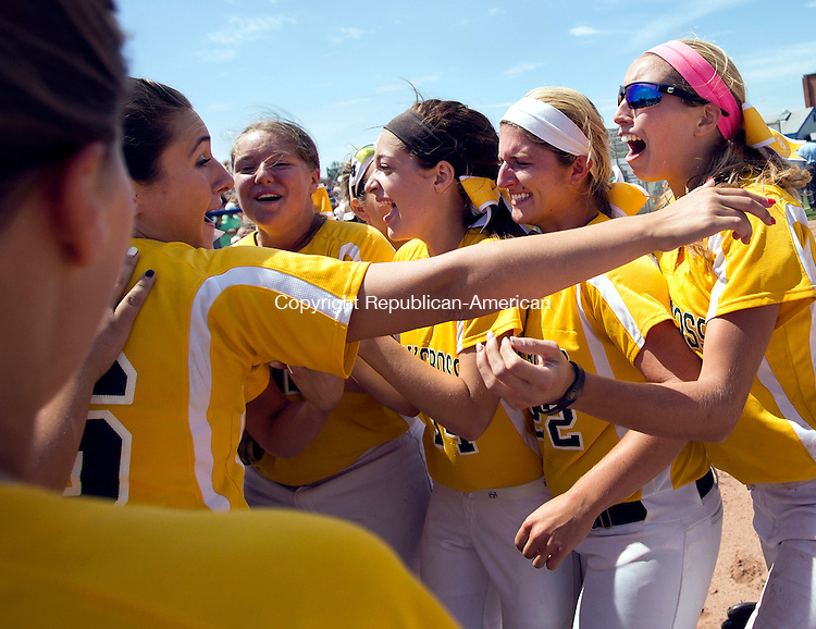 West Haven, CT- 13 June 2015-061315CM17-   The Holy Cross girls softball team celebrate following a 4-0 win over Thomaston to capture the Class S state softball title in West Haven on Saturday.  Christopher Massa Republican-American