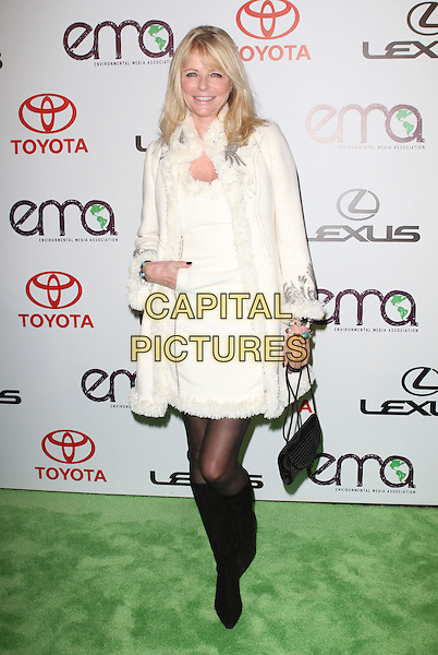 CHERYL TIEGS .at The 2010 Environmental Media Association Awards held at Sky Bar, Warner Bros Studios, Burbank, California, USA, October 16th 2010. .emas ema full length cream white coat fur trimmed dress black knee high boots tights hand in pocket bag .CAP/ADM/KB.©Kevan Brooks/AdMedia/Capital Pictures.