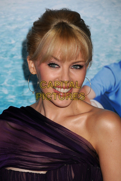 KYLIE MINOGUE.G'Day USA: Australia.com 2008 Black Tie Gala at the Hollywood & Highland Ballroom, CaliforniaUSA,.19 January 2008..portrait headshot fringe gold hoop earrings purple.CAP/ADM/BP.©Byron Purvis/AdMedia/Capital Pictures.