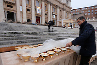 Preparativi prima di una messa celebrata da Papa Francesco per l'apertura ufficiale del Giubileo della Misericordia, in Piazza San Pietro, Citta' del Vaticano, 8 dicembre 2015.<br /> A Vatican employee prepares chalices prior to the start of a mass celebrated by Pope Francis to officially open the Jubilee of Mercy, in St. Peter's Square at the Vatican, December 8, 2015.<br /> UPDATE IMAGES PRESS/Riccardo De Luca<br /> <br /> STRICTLY ONLY FOR EDITORIAL USE